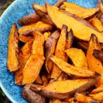 sweet potato wedges in a green bowl