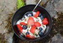 Greek yogurt with sliced strawberries, blueberries and seeds