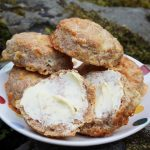 wholemeal cheese scones with butter on a plate