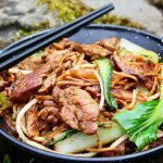 Beef Chow Mein on plate with chopsticks
