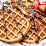 coconut flour flaxseed waffles with chocolate drizzle hazelnuts and strawberries